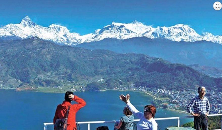 Annapurna Range on top and beautiful Lake city Pokhara at Bottom - seen from Sarangkot.