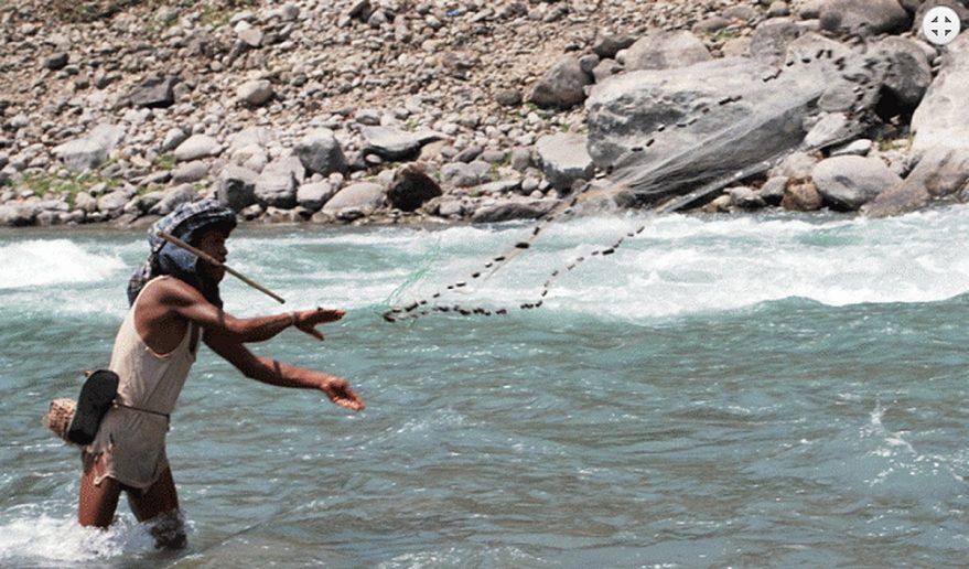Native doing Traditional Fishing.